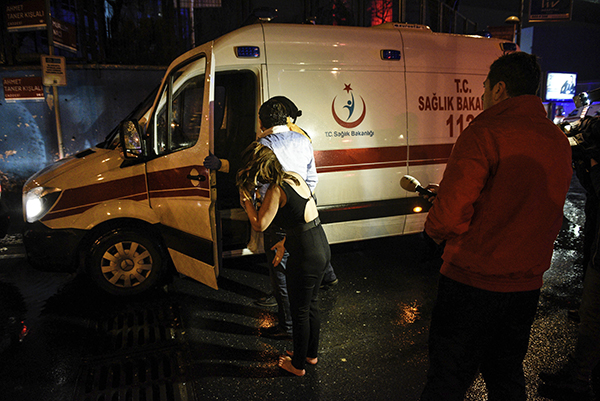 <div class='meta'><div class='origin-logo' data-origin='AP'></div><span class='caption-text' data-credit='AP Photo'>People talk to medics in an ambulance near the scene of an attack in Istanbul, early Sunday, Jan. 1, 2017.</span></div>