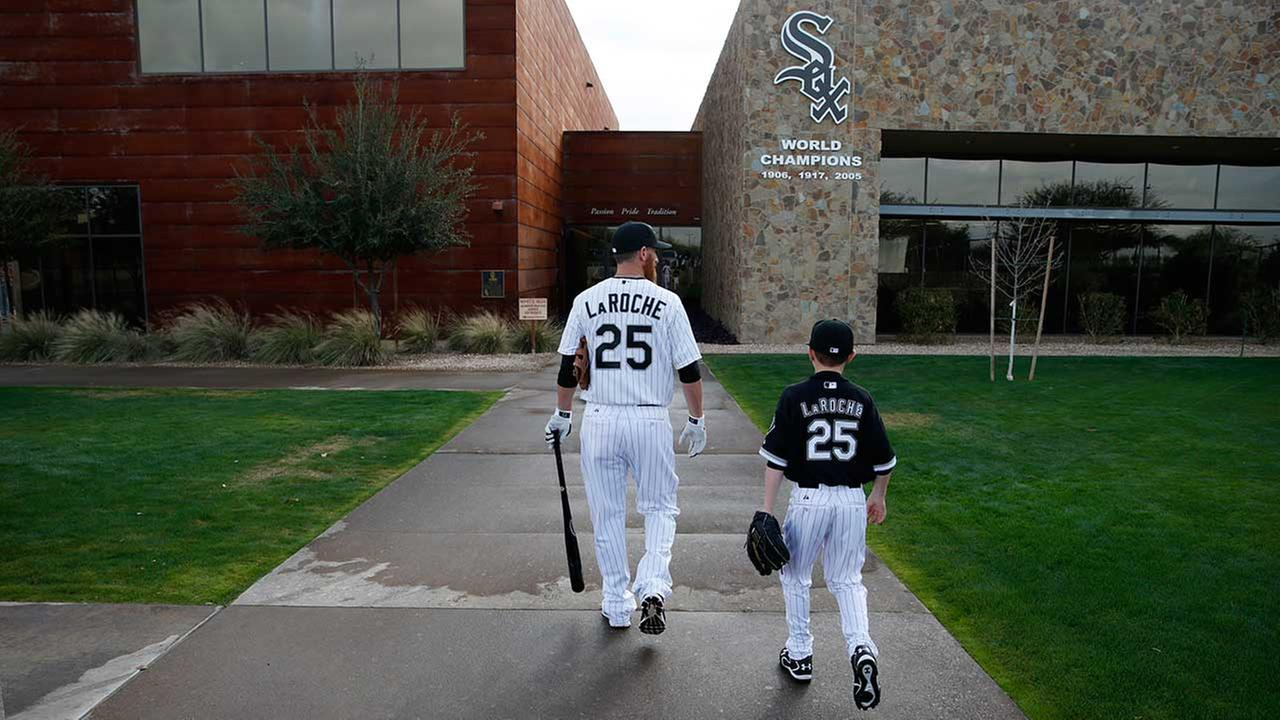 Chicago White Soxs Adam LaRoche, left, and his son Drake walk to the White Sox clubhouse.