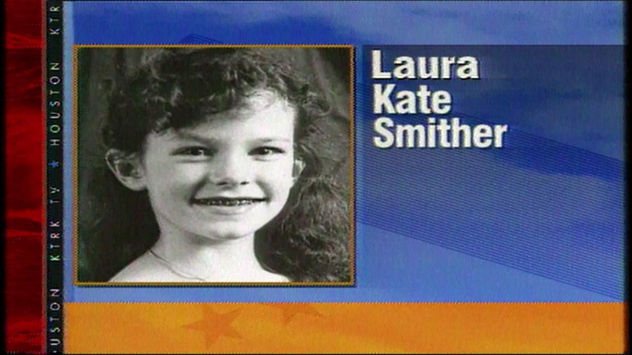 Photos of Laura Smither are shown across the community as thousands search for the 12-year old