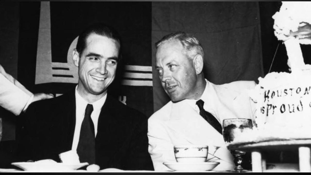 Howard Hughes and Noah Dietrich at a banquet table in Rice Hotel, Houston, Texas. Photo: Houston Public Library-HMRC