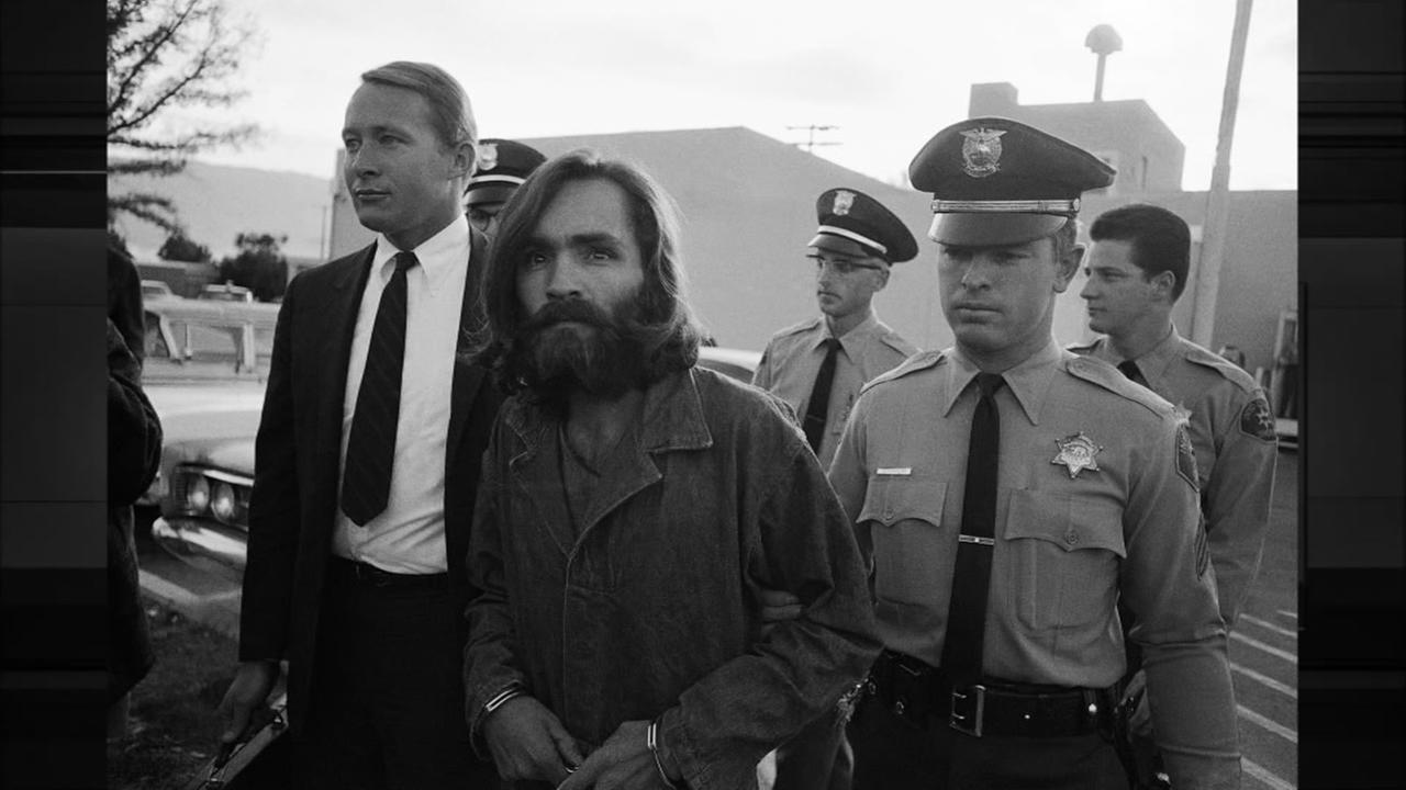Charles M. Manson, leader of a hippie cult accused of multiple murders, leaves a Los Angeles courtroom, Dec. 22, 1969 after telling a judge lies have been told about him.