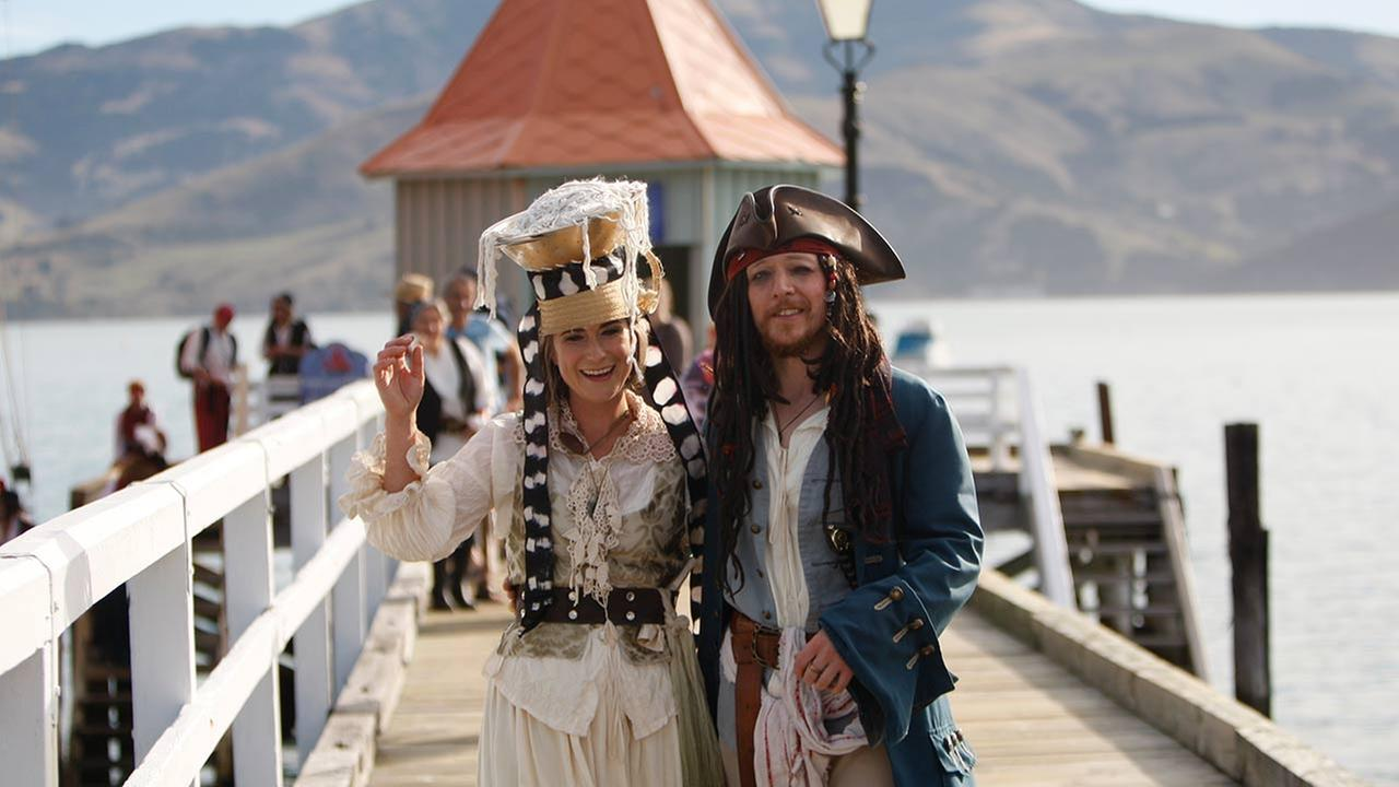 Bride Marianna Fenn and bridegroom Toby Ricketts stand on a jetty in Akaroa harbor, New Zealand, Saturday April 16, 2016. New Zealand hosted the worlds first Pastafarian wedding.