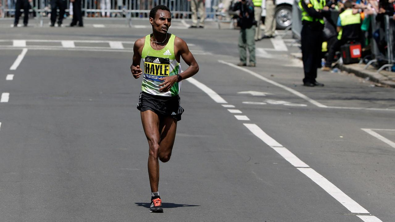 Lemi Berhanu Hayle, of Ethiopia, runs alone in the final stretch before winning the 120th Boston Marathon on Monday, April 18, 2016, in Boston.