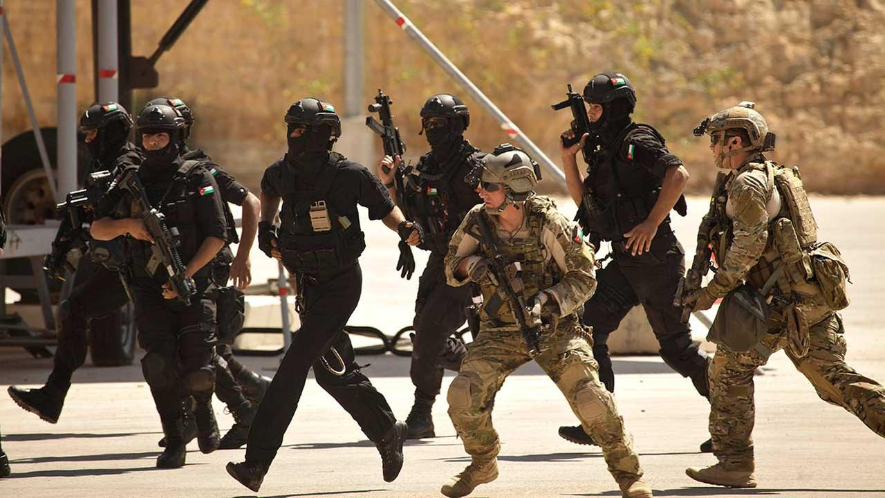 In this Thursday, June 20, 2013 photo, special operations forces from Jordan and the U.S. conduct a combined demonstration with commandos from Iraq