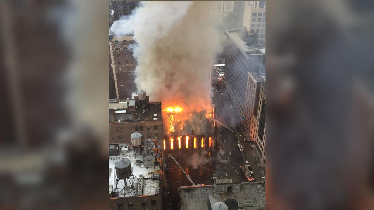 Firefighters battle flames at an historic Serbian Orthodox Cathedral of St. Sava in New York, Sunday, May 1, 2016. The church was constructed in the early 1850s and was designated