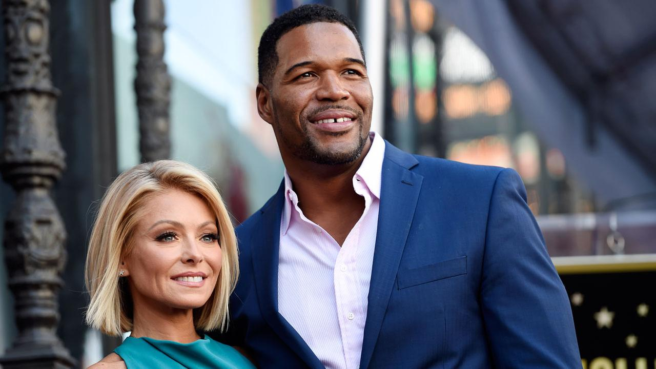 Kelly Ripa, left, poses with Michael Strahan  during a 2015 ceremony honoring Ripa with a star on the Hollywood Walk of Fame in Los Angeles.