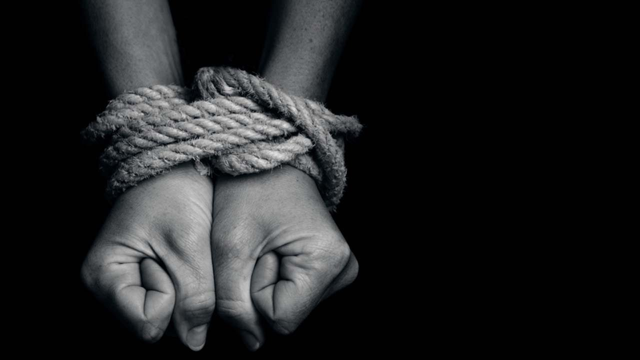 A stock image of a person in bondage