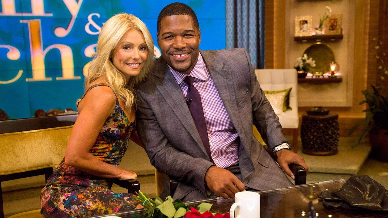 In this Sept. 4, 2012 file photo, Michael Strahan, right, joins Kelly Ripa on Live! with Kelly and Michael on his first day as an official co-host.