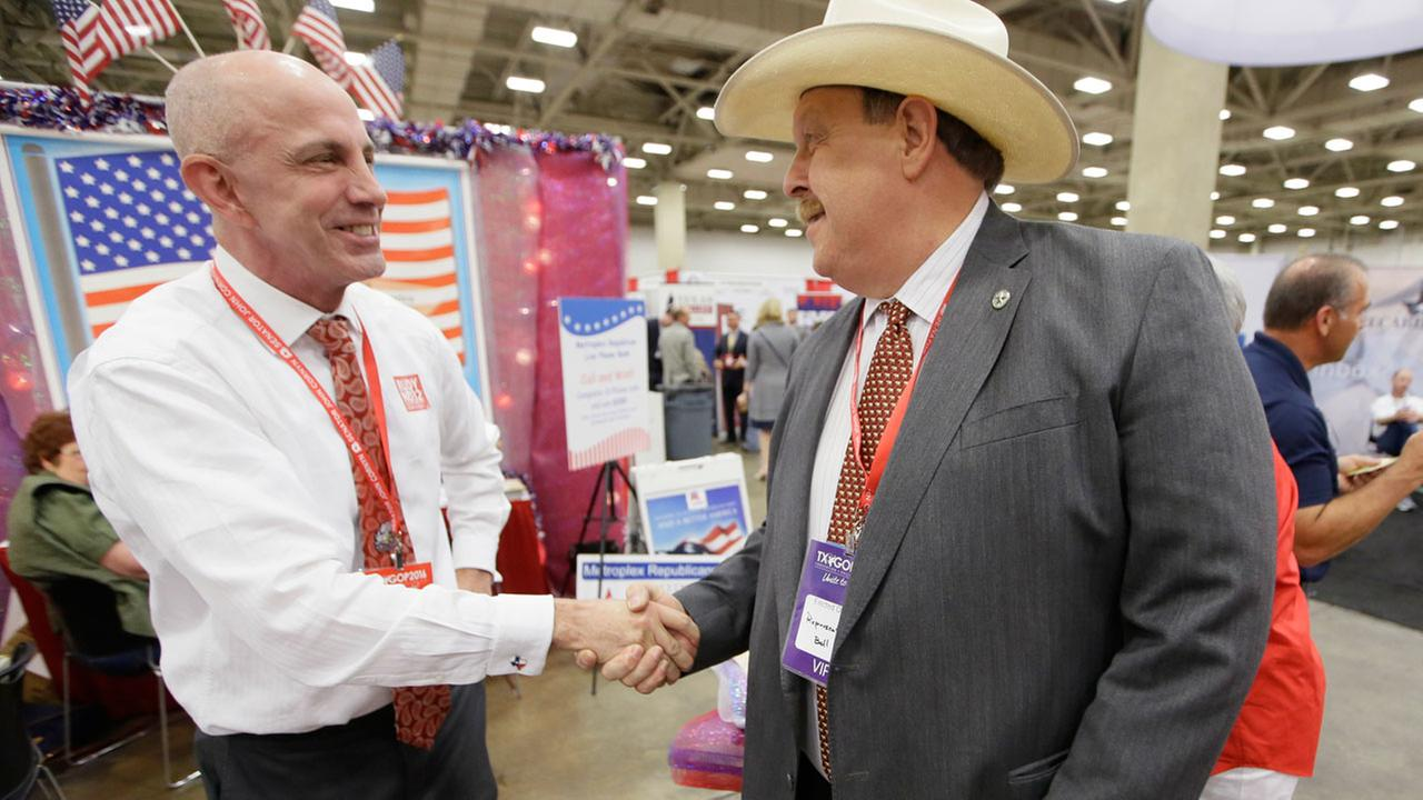 Dallas County delegate Rudy Oeftering, left, shakes hands with Texas Rep. Cecil Bell, R-Magnolia. Oeftering is an openly gay Republican pushing for more inclusion in the party.