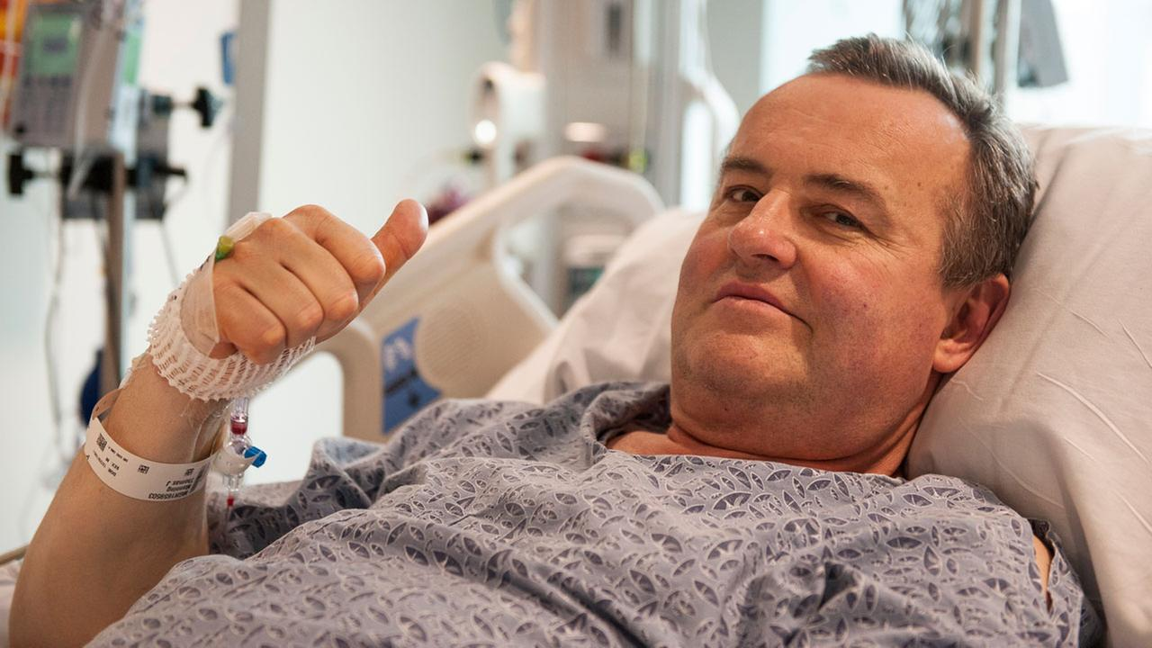 Thomas Manning gives a thumbs up after being asked how he was feeling following the first penis transplant in the United States, in Boston.