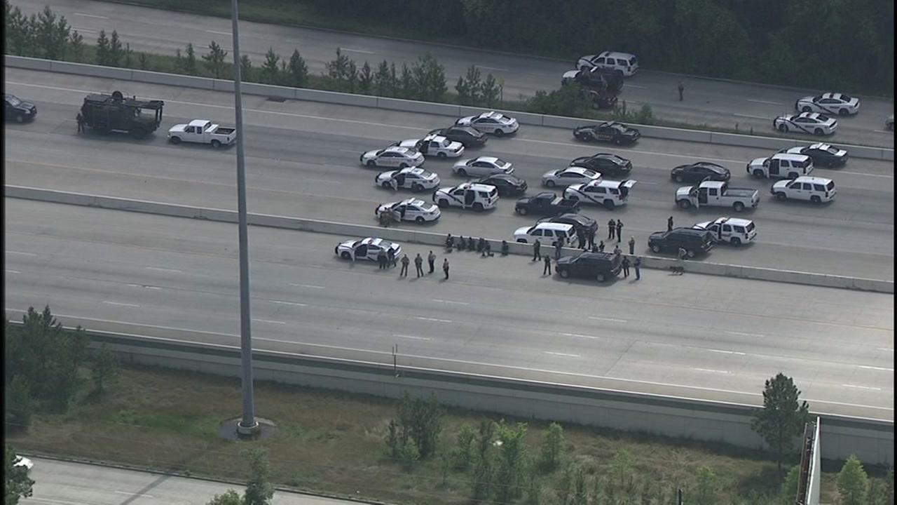Photos from chase and standoff along North Freeway in Montgomery County