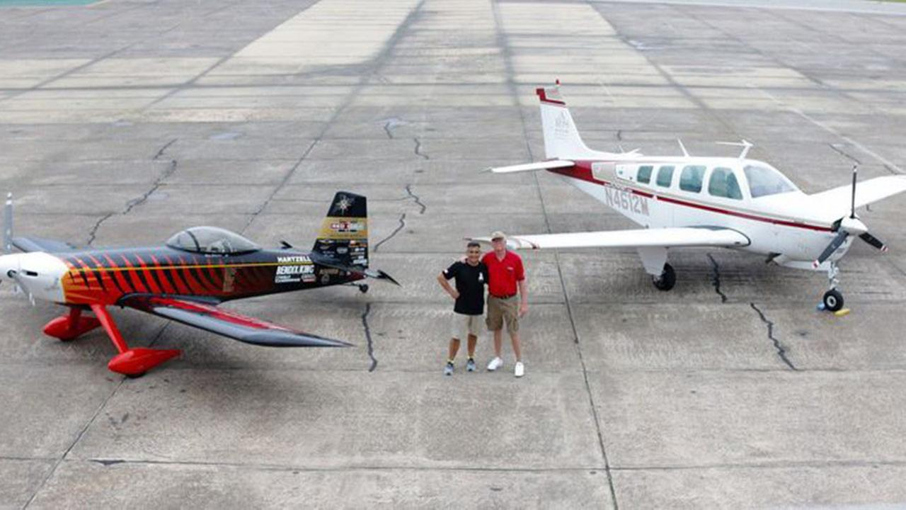 Bruce Bohannon and Alex Tapia posing with the World Record Breaking Flyin Tiger and the ARS A36 Bonanza.
