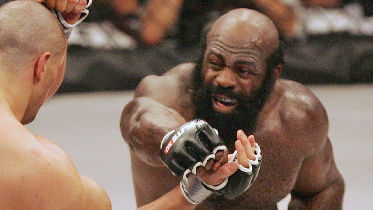 Kimbo Slice, right, throws a punch at James Thompson of Manchester, England