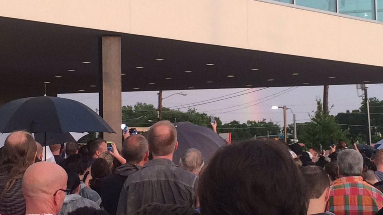 A rainbow appears over a vigil in Dallas.Emily Black/City of Dallas