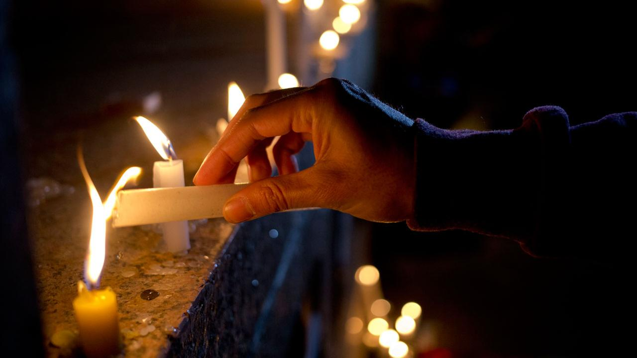 A man lights a candle during a vigil in front of the U.S. embassy to remember the victims of the mass shooting at the Pulse nightclub, in Santiago, Chile.AP Photo/Esteban Felix