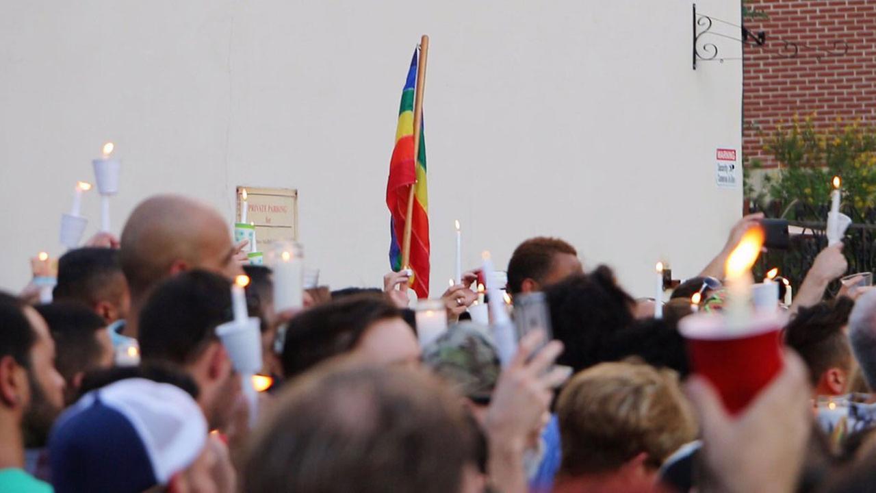 A demonstrator raises a rainbow flag during an event in Chicago.Tiernan Bertrand-Essington/Twitter