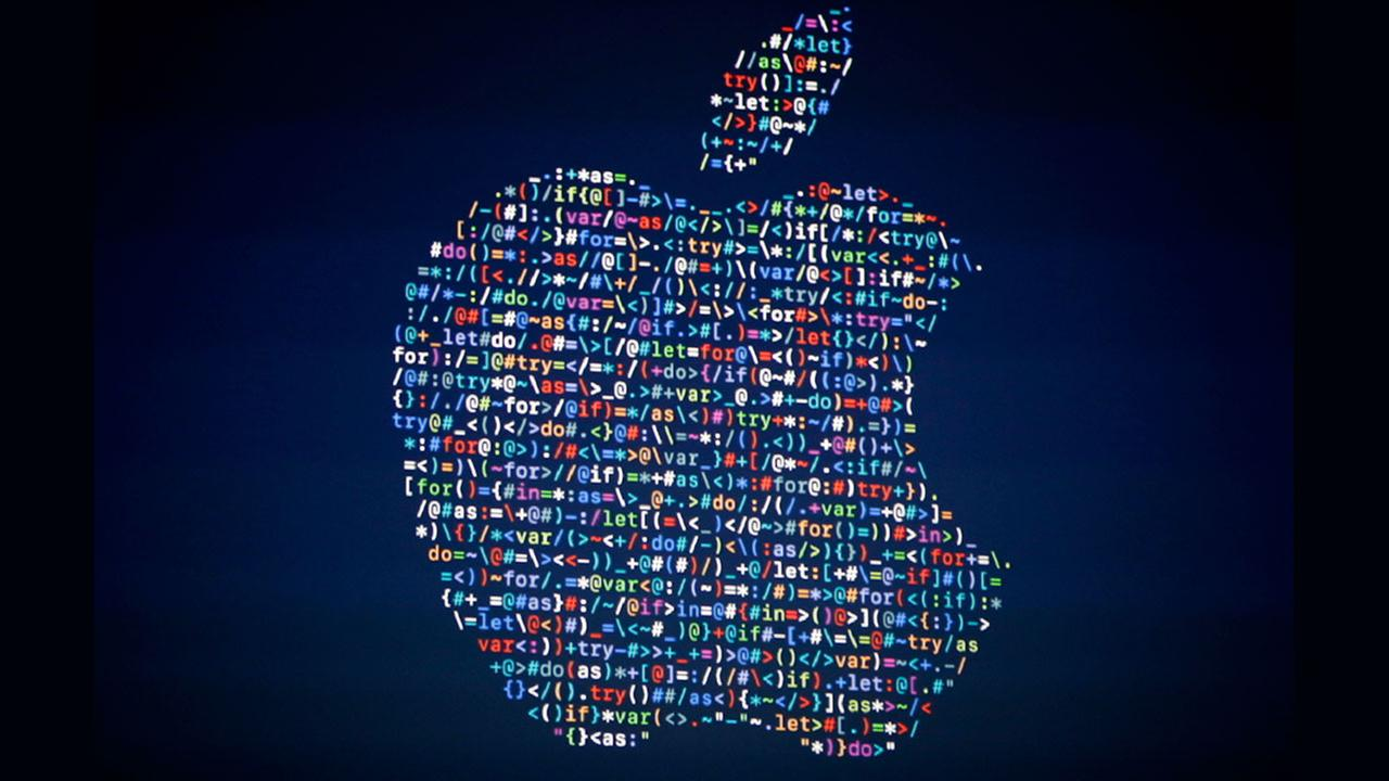 The Apple logo is shown on a screen at the Apple Worldwide Developers Conference in the Bill Graham Civic Auditorium, San Francisco, Monday, June 13, 2016.