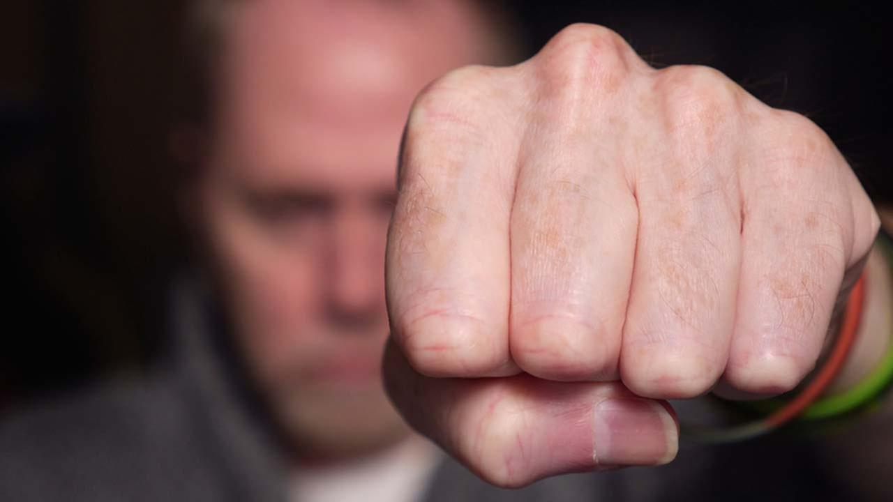 A stock photo of a punching hand