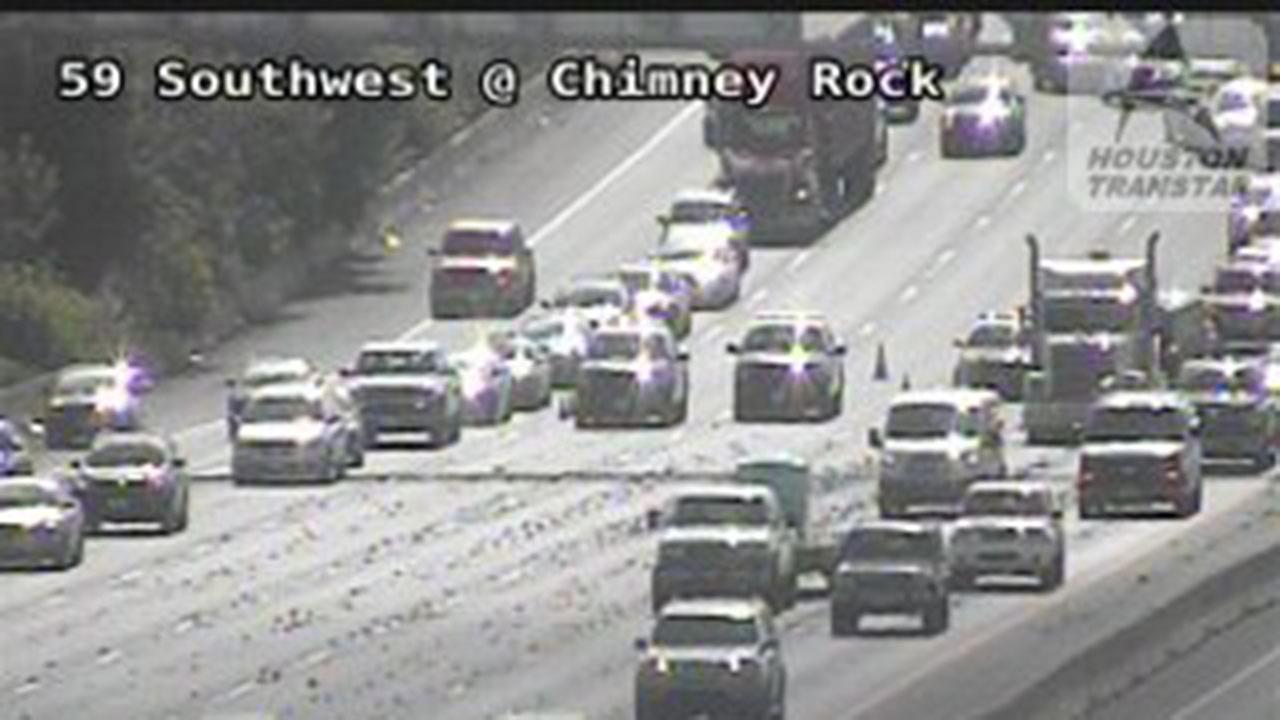 TRAFFIC ALERT: 2 center lanes closed due to gravel on US-59 SB at Chimney Rock