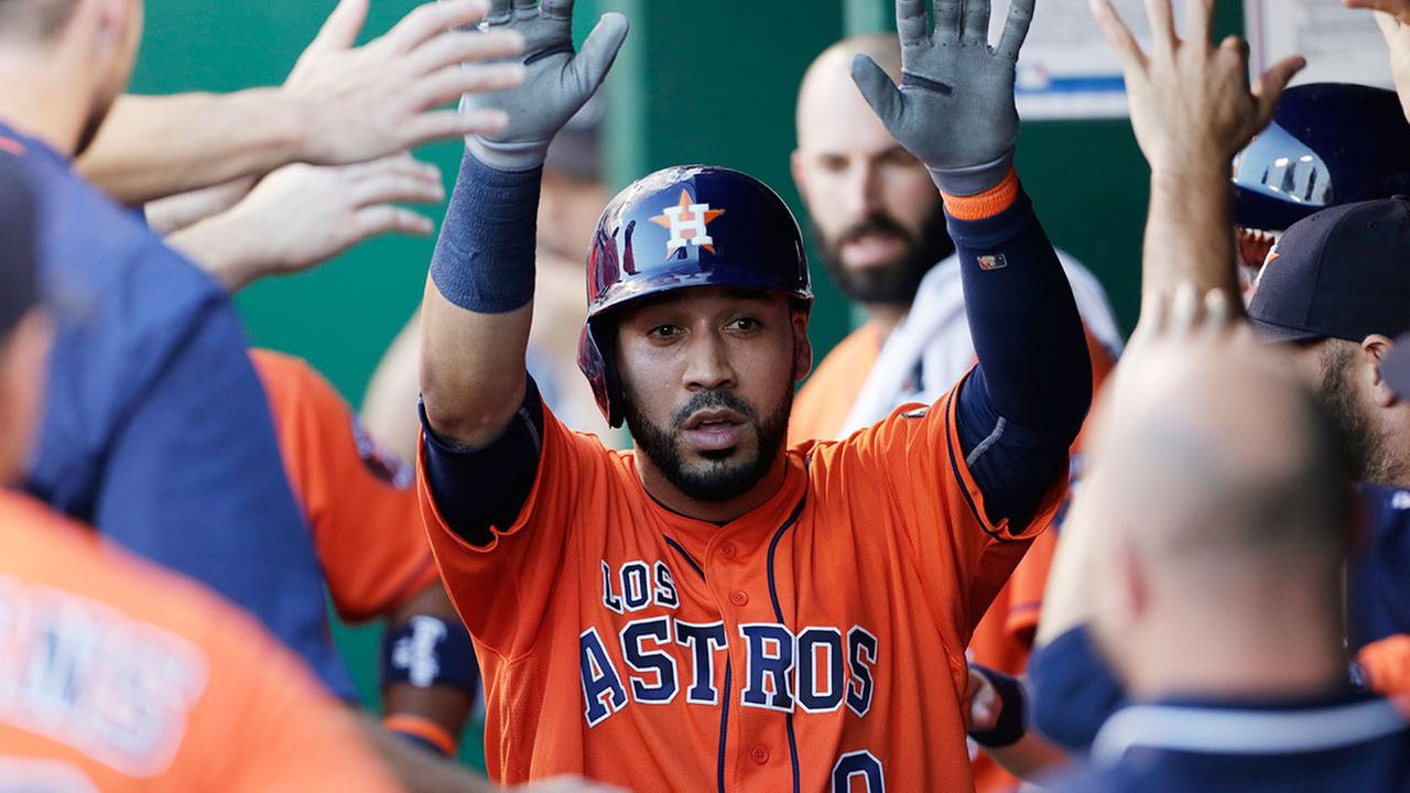 Houston Astros Marwin Gonzalez (9) is congratulated in the dugout after hitting a solo home run in the fourth inning