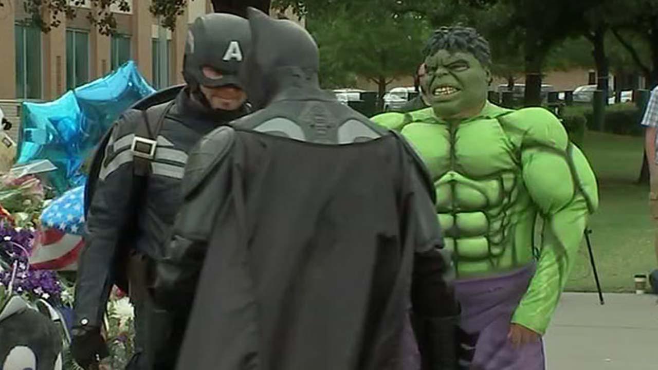 Superheroes visit Dallas memorial