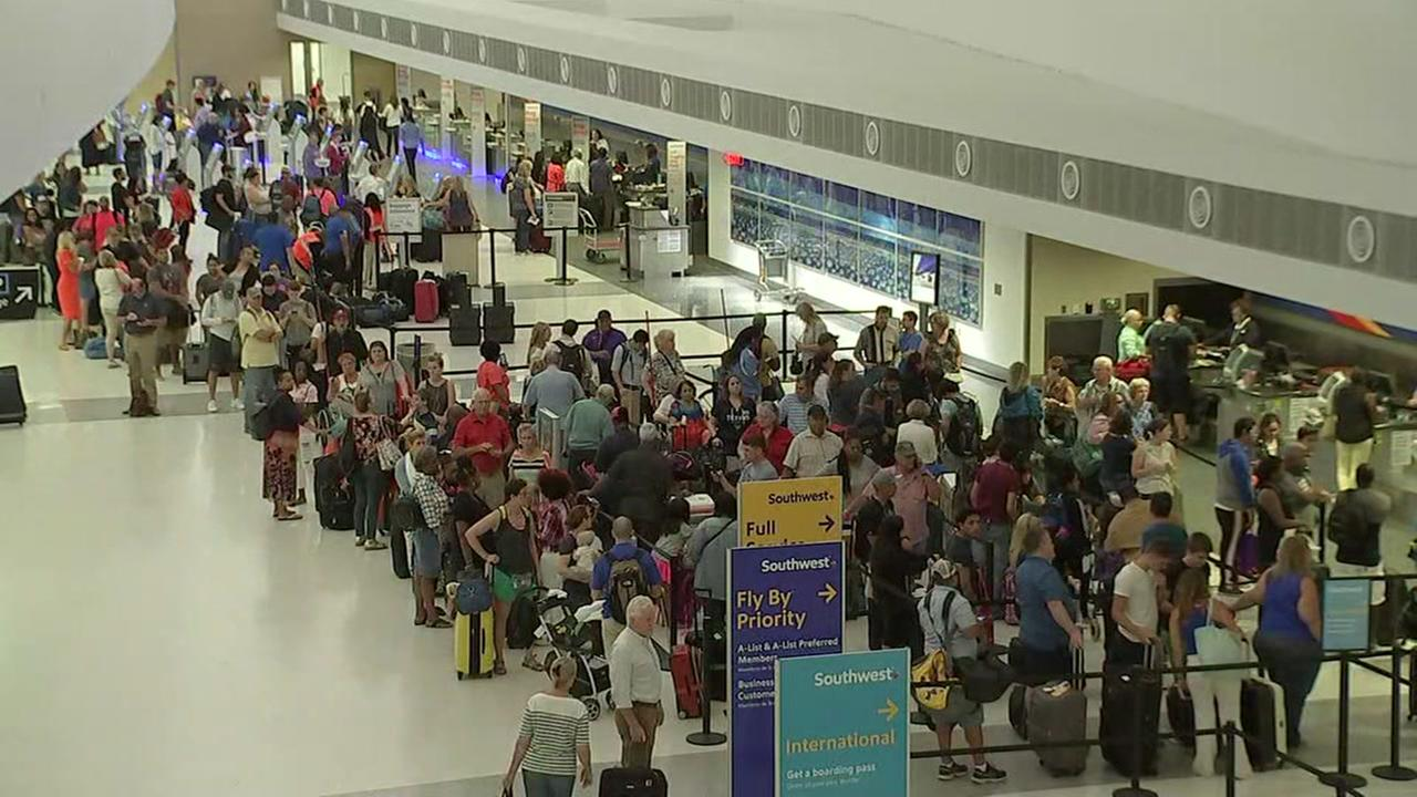 Southwest suffers technology outage; flights held at gates
