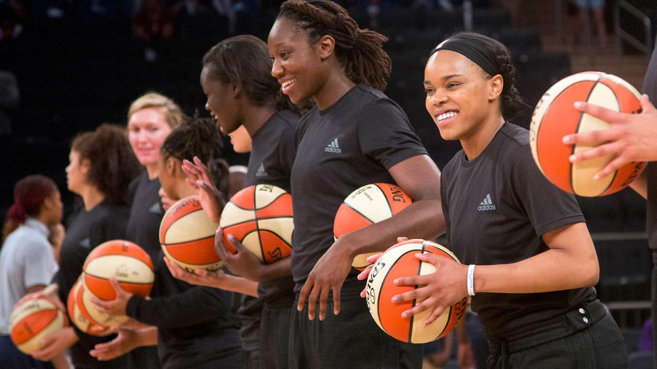 The WNBA is withdrawing fines against several teams and their players for wearing plain black warm-up shirts in the wake of recent shootings by and against police.