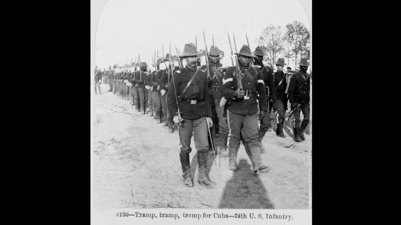Buffalo soldiers of the 24th U.S. Infantry -- Tramp, tramp, tramp for Cuba! stereo-card ca. 1898