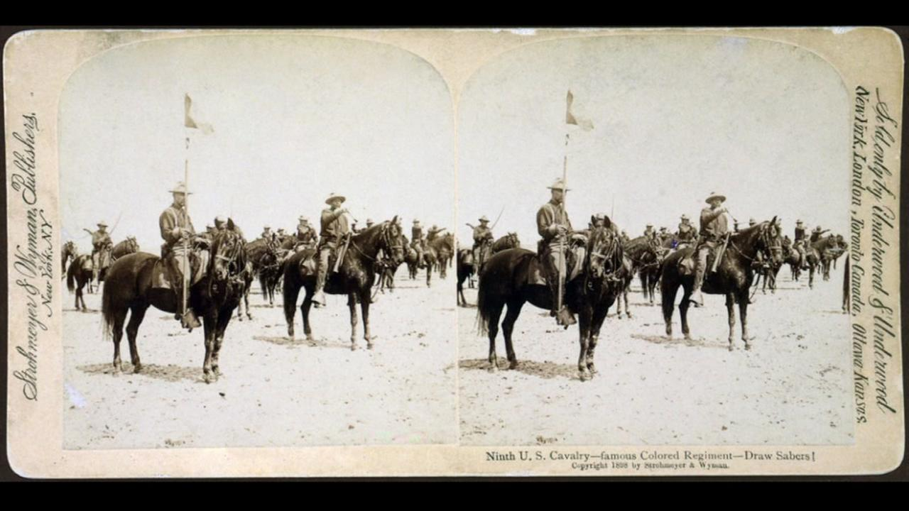 Buffalo soldiers of the Ninth U.S. Cavalry--famous Colored Regiment--Draw Sabers! stereo-card ca. 1898