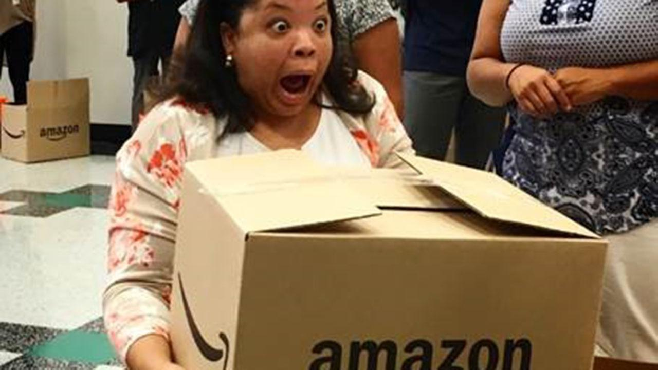Surprised teacher receives box of school supplies from Amazon.