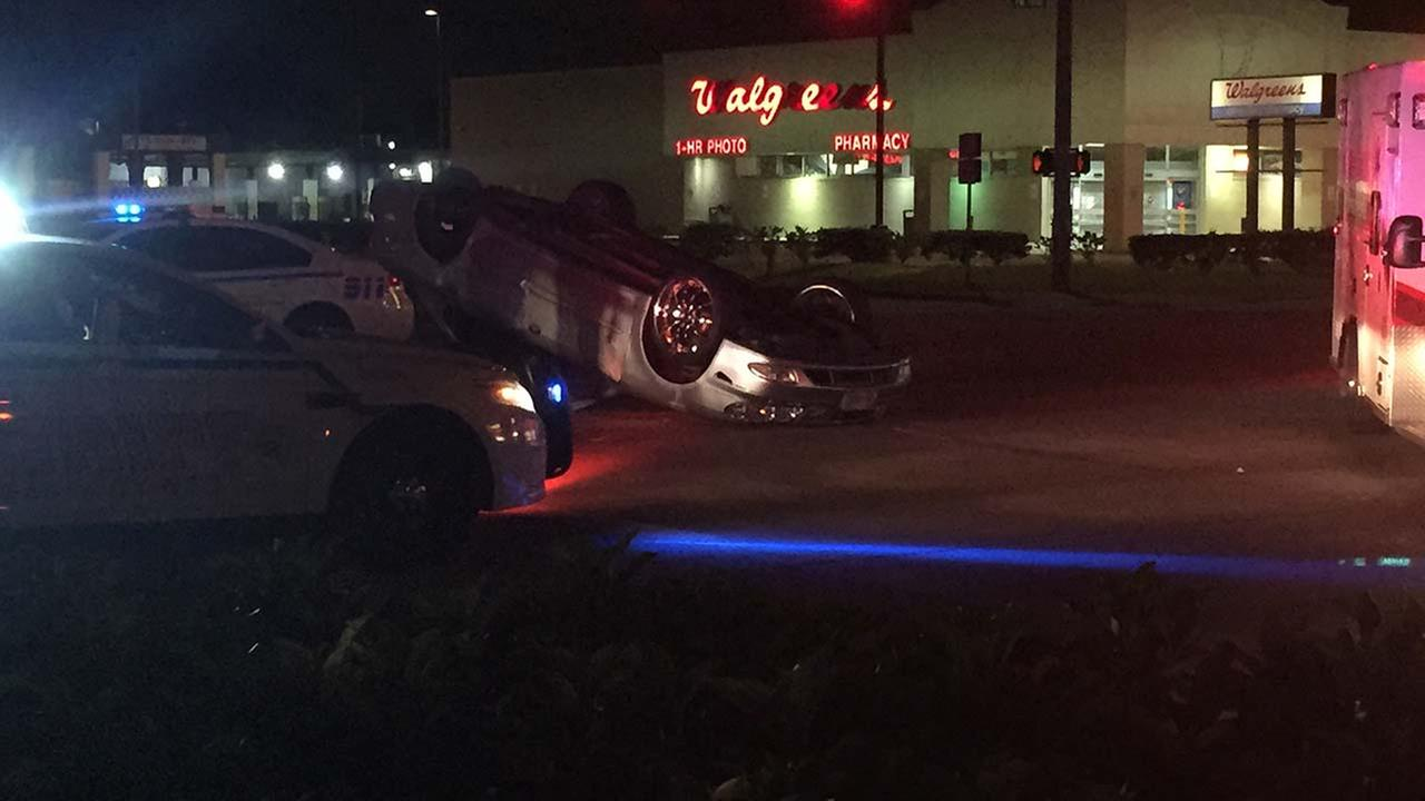 Car flips after hitting a patrol unit in north Harris County