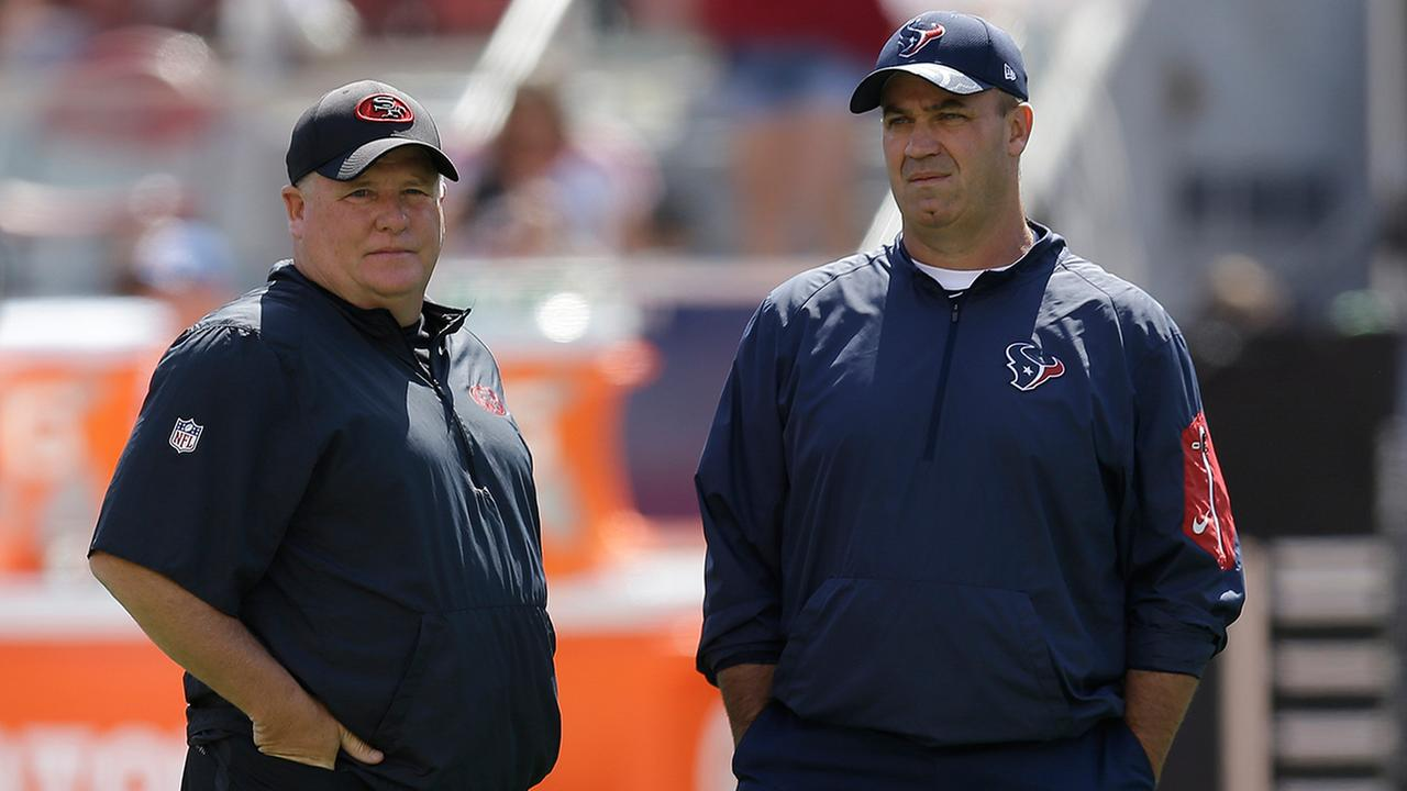 San Francisco 49ers head coach Chip Kelly, left, and Houston Texans head coach Bill OBrien, right, talk before the start of an NFL preseason football game Sunday, Aug. 14, 2016.AP Photo/Ben Margot