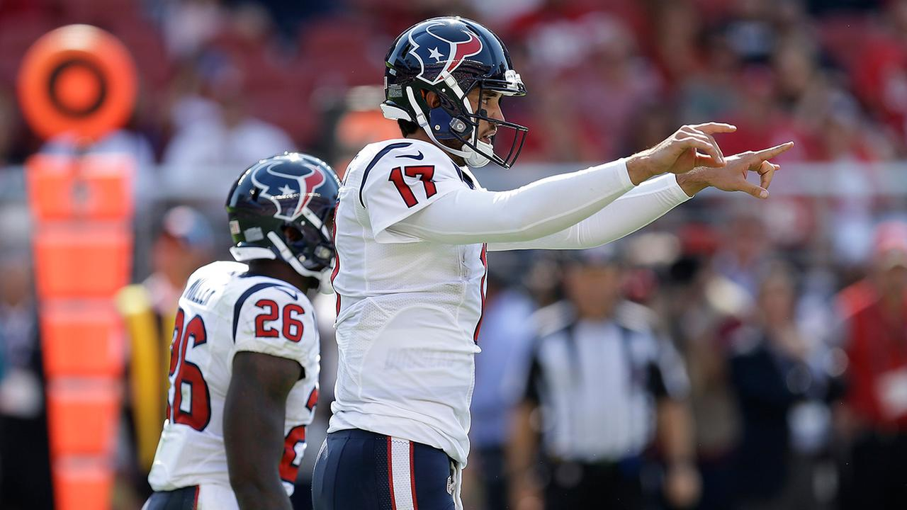 Houston Texans quarterback Brock Osweiler directs a play with running back Lamar Miller (26) at left during the first half of an NFL preseason football game.AP Photo/Ben Margot