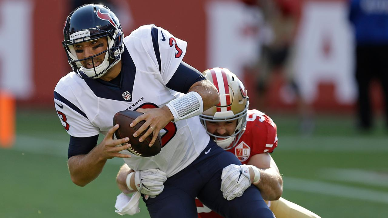 Houston Texans quarterback Tom Savage is sacked by San Francisco 49ers linebacker Nick Bellore during the first half of an NFL preseason football game.AP Photo/Ben Margot