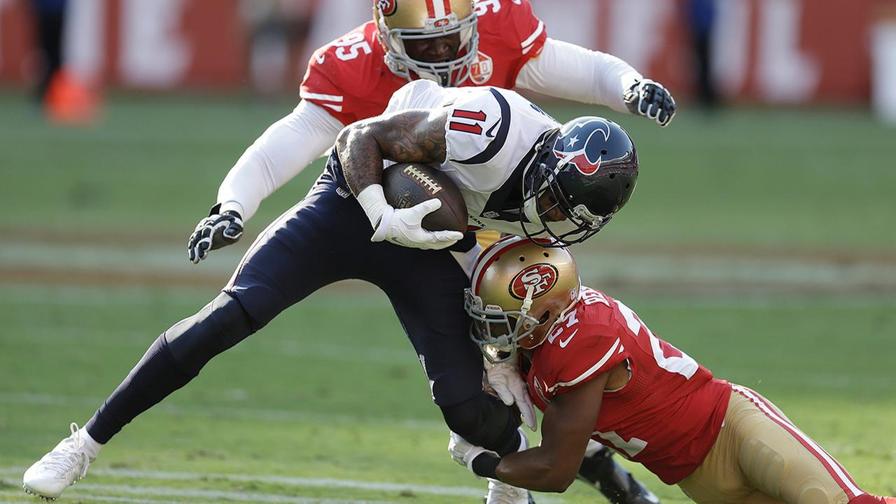 Houston Texans wide receiver Jaelen Strong is stopped with the ball by San Francisco 49ers defensive tackle Tank Carradine (95) and cornerback Keith Reaser (27).AP Photo/Ben Margot