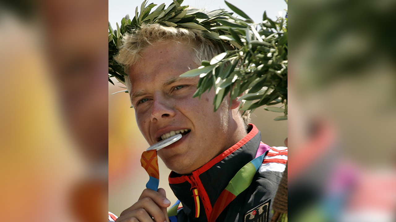 In this Aug. 20, 2004 photo, Germanys Stefan Henze bites his silver medals during a medal ceremony for the C2 mens canoe event.