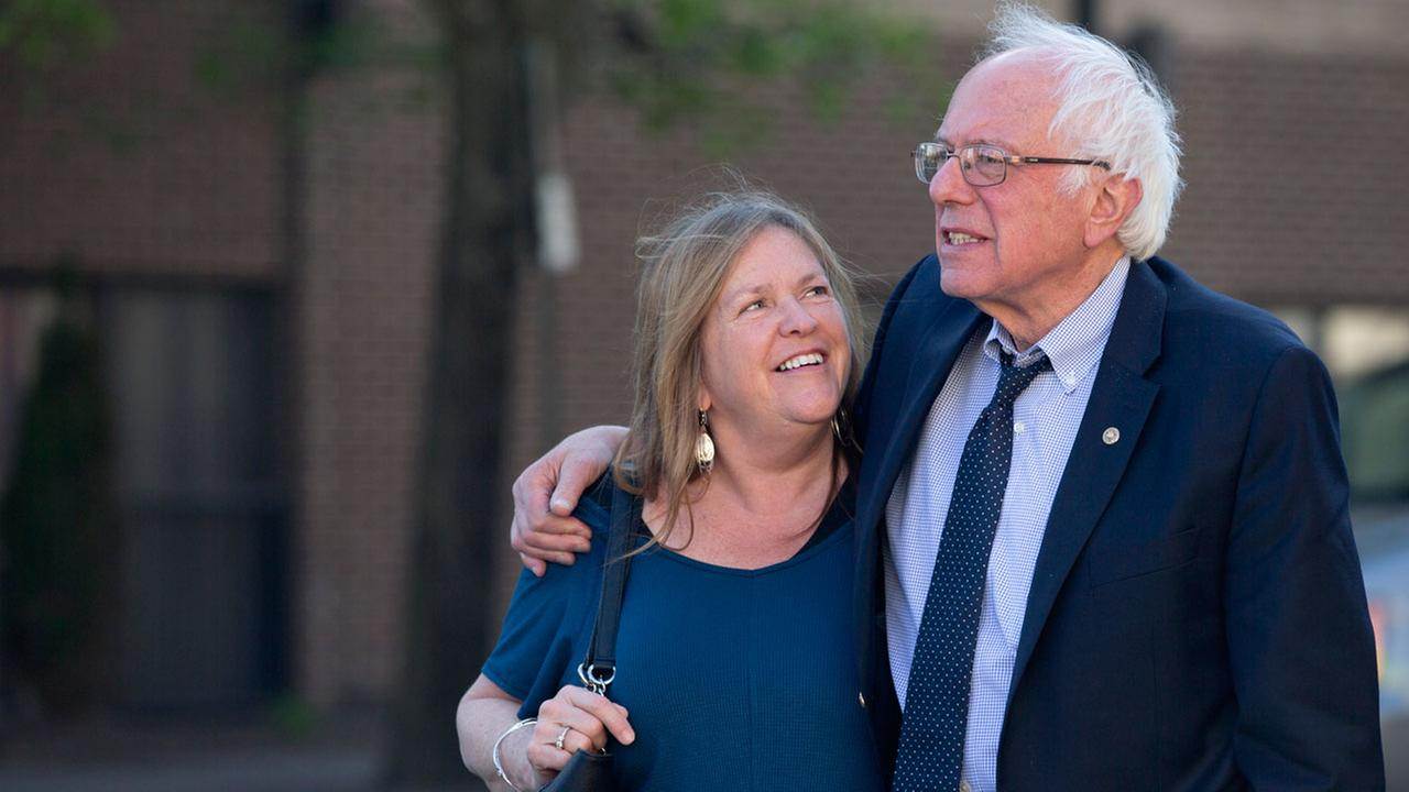 Former Democratic presidential candidate Sen. Bernie Sanders, I-Vt., and his wife Jane take a walk in State College, Pa., Tuesday, April 19, 2016.