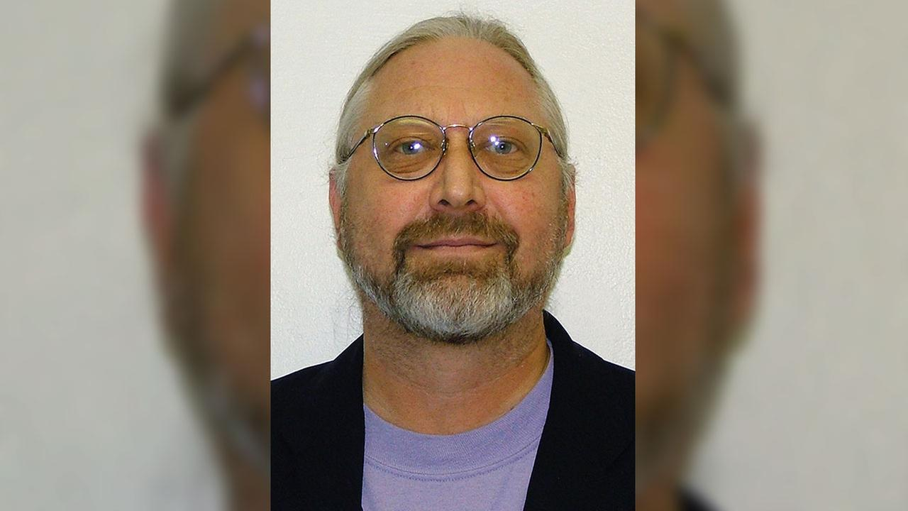A woman has been charged along with a man in the death of Penn State professor Ronald Bettig, who police say was pushed off a cliff at a quarry and fell 80 feet.