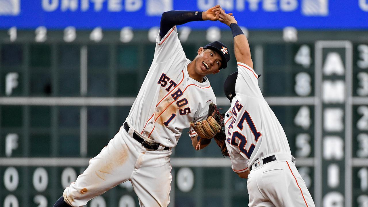 Carlos Correa and Jose Altuve celebrate