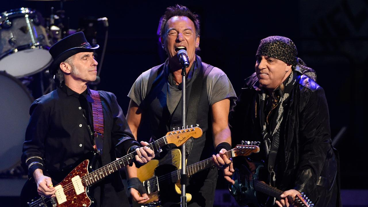 Bruce Springsteen, center, performs with Nils Lofgren, left, and Steven Van Zandt of the E Street Band during their concert at the Los Angeles Sports Arena in Los Angeles.