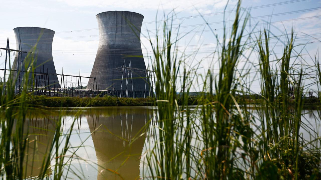 Two cooling towers can be seen in the reflection of a pond outside of the Bellefonte Nuclear Plant, in Hollywood, Alabama.
