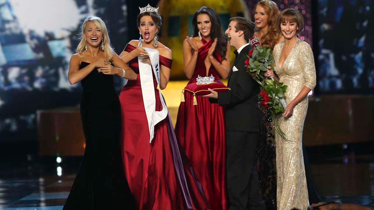 The outgoing Miss America, Betty Cantrell,second left, reacts as she tries to put a Miss America sash on winner Miss Arkansas Savvy Shields during the Miss America 2017 pageant.AP