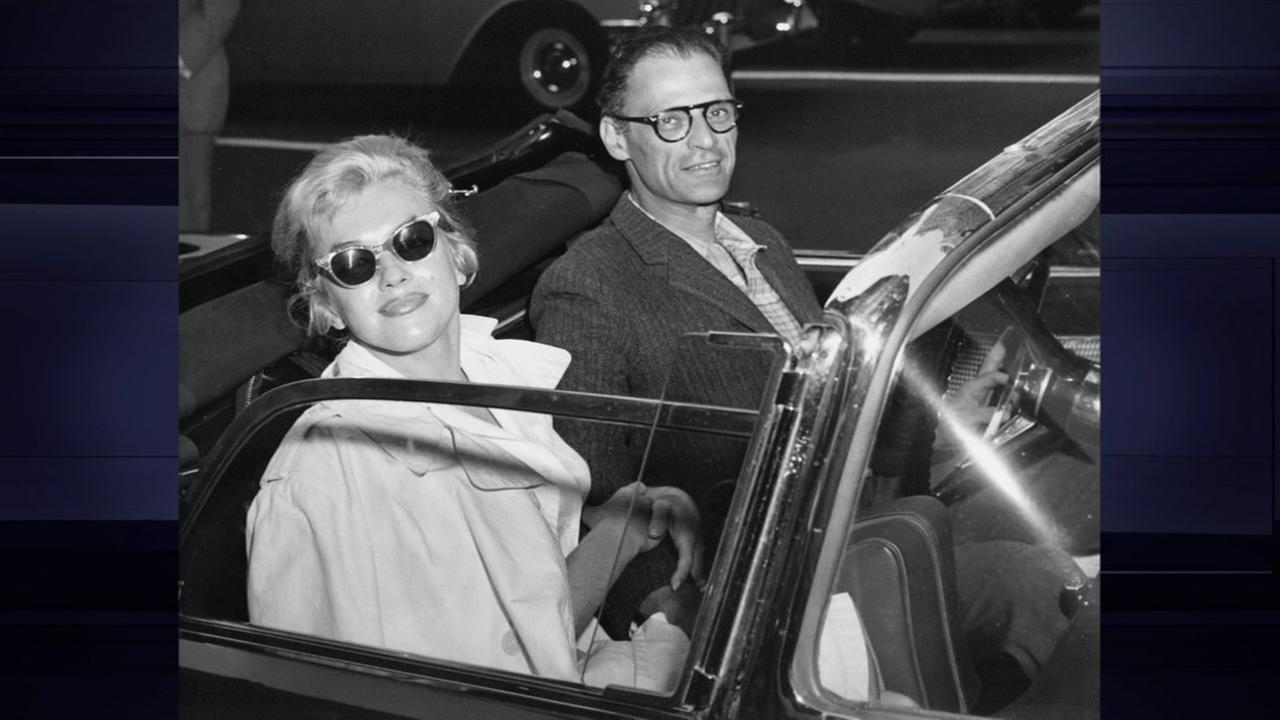 Playwright Arthur Miller and actress wife Marilyn Monroe wait in car to leave their residence in New York City on May 31, 1957.