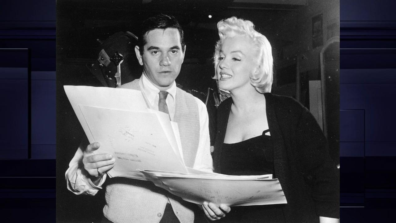 Marilyn Monroe with photographer Milton H. Greene, in his studio in New York, N.Y., Jan. 27, 1955. The couple became friends when he was photographing her for a magazine. (AP Photo