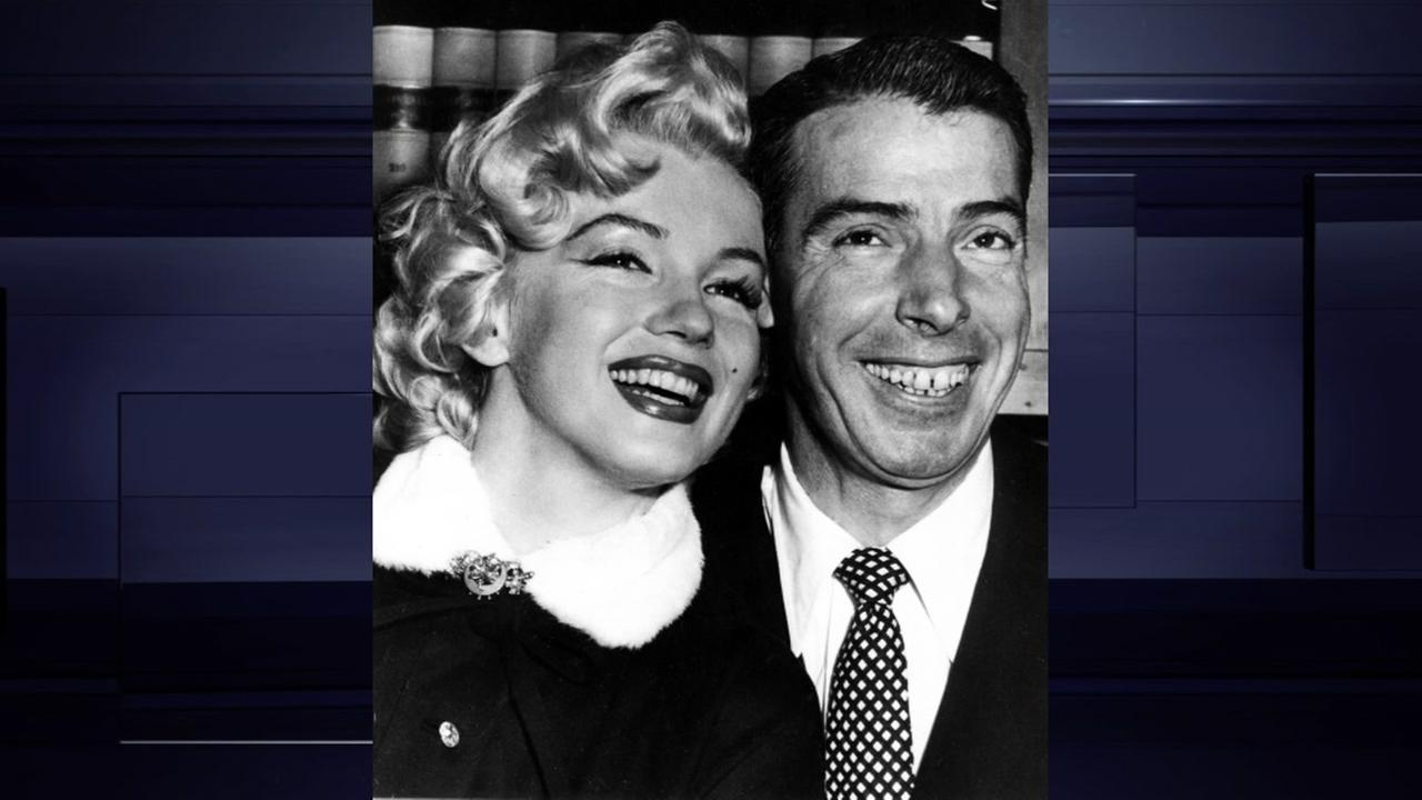 Joe Dimaggio, baseballs famed Yankee Clipper and Marilyn Monroe, smile cheek to cheek as they wait patiently in Judge Charles Perrys chambers for their marriage ceremony