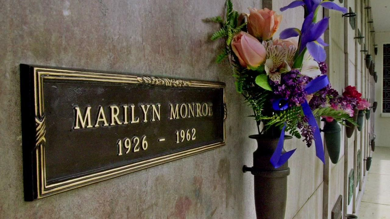 A bouquet of fresh flowers adorns the crypt of movie star Marilyn Monroe, heavily smudged from the hands of thousands of visitors, at Westwood Cemetery in Los Angeles