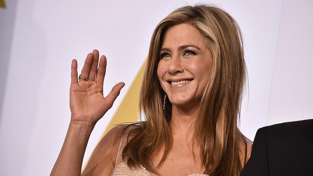 Jennifer Aniston poses in the press room at the Oscars on Sunday, Feb. 22, 2015, at the Dolby Theatre in Los Angeles.