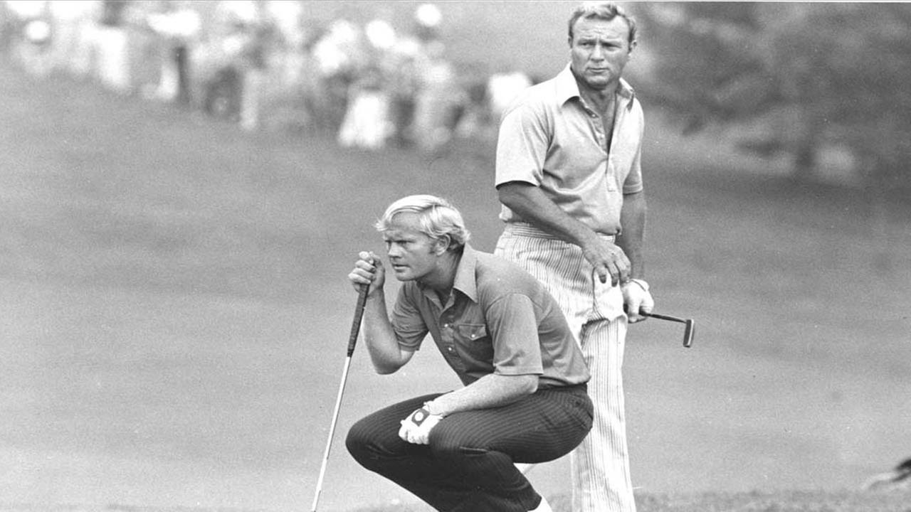 Jack Nicklaus kneels as partner Arnold Palmer looks over his shoulder while they study a putt on 18th green at Laurel Valley Golf Club at the PGA National Team Championship in 1972Associated Press