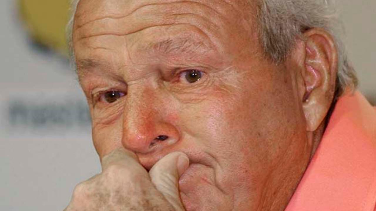 Arnold Palmer fights back tears during a post second round news conference at his final Masters, Saturday, April 13, 2002.AP