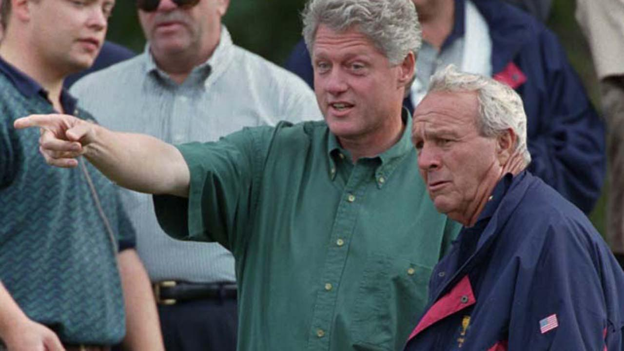 President Clinton talks to captain of the Presidents Cup captain, Arnold Palmer on the 14th green at the Robert Trent Jones Golf Club Friday, Sept. 13, 1996.ASSOCIATED PRESS